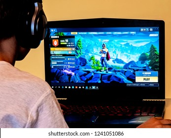 Vilnius, Lithuania - November 12, 2018: Boy playing Fortnite. Fortnite is online video game developed by Epic Games