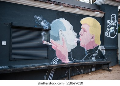 VILNIUS, LITHUANIA - November 20, 2016: Russian President Vladimir Putin and U.S. president Donald Trump are kissing on the side of a barbecue restaurant.  LITHUANIA-US-MURAL-TRUMP-PUTIN.