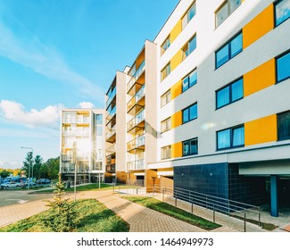 Vilnius, Lithuania - October 1, 2018: Apartment EU modern houses and homes residential buildings complex real estate concept. Street and an outdoor. At sunset