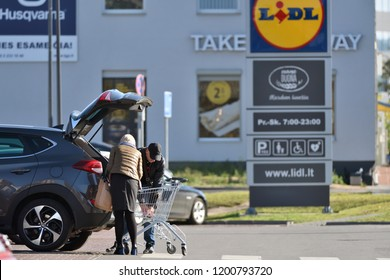 Vilnius, Lithuania, October 10: Unidentified people and logo of Lidl Supermarket on October 10, 2018 in Vilnius, Lithuania. Lidl is a German global discount supermarket chain spread all accross Europe