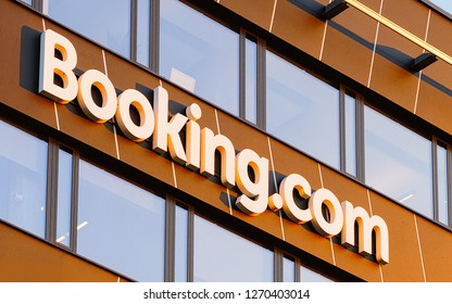 Vilnius, Lithuania - October 11, 2018: Booking.com logo on the modern business office building. Blue sky