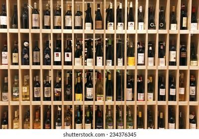VILNIUS, LITHUANIA - OCTOBER 5, 2013: Variety of wine bottles on wooden shelf in wine store in Vilnius, Lithuania