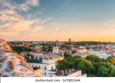 Vilnius, Lithuania. Old Town Historic Center Cityscape Under Dramatic Sky And Bright Sun In Sunny Summer Day. UNESCO World Heritage. Famous And Popular Place.