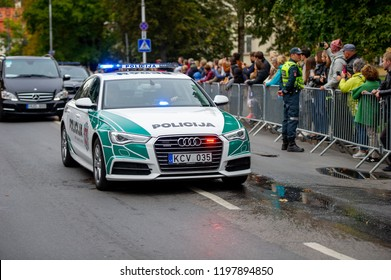 VILNIUS, LITHUANIA - SEP 22, 2018: Lithuanian police escort vehicle Audi A6 in Vilnius old town. The main policing institution in Lithuania is the Lithuanian Police.