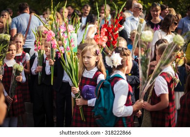 Vilnius, Lithuania - September 1, 2015: Schoolgirls and schoolboys came to the school for the first time. They watch some festive event on September 1, 2015 in Vilnius, Lithuania.