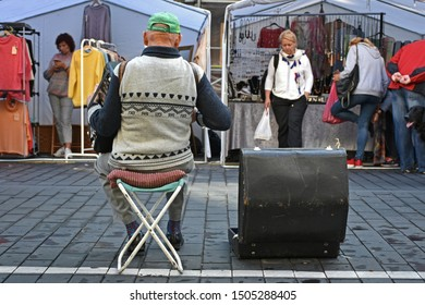 Vilnius, Lithuania - September 14, 2019: The Old Man Plays the Accordion