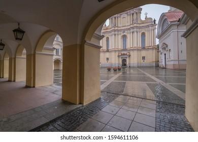 Vilnius, Lithuania - September 28, 2019: View of the Great (Skarga) Courtyard in autumn rain, most splendid courtyard at Vilnius University, major tourist attraction in Old Town Vilnius.