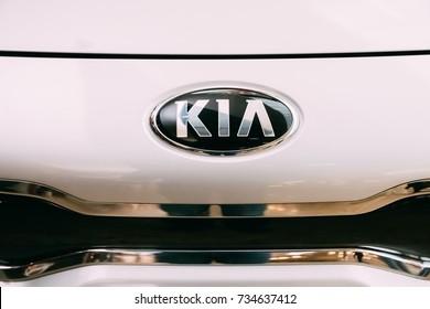 Vilnius, Lithuania - Stptember 30, 2017: Close The Oval Logo Of Kia Motors At White Hood Of New Kia Rio Car Represented In Acropolis Shopping Center.