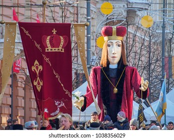 VILNIUS, LITHUANIA-MARCH 4, 2018: Giant figure of Saint Casimir carrying by people at traditional theatrical Kaziukas (Saint Casimir's) procession