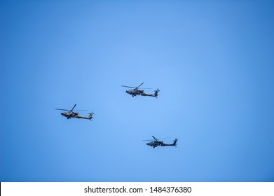 VILNIUS - MAR 22: US Army Apache AH-64 Helicopters during the Dragoon Ride Exercise on March 22, 2015 in Vilnius, Lithuania. The Boeing AH-64 Apache is a four-blade, twin-turboshaft attack helicopter.