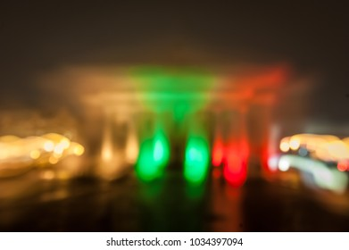 The Vilnius Town Hall illuminated in the colors of the Lithuanian flag to mark the 100th anniversary of the restoration of Lithuanian statehood. Long exposure. Abstract flag.