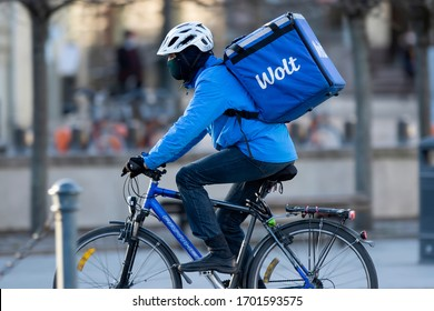 Vilnius/Lithuania April 11, 2020 Wolt courier with bicycle. Wolt is the one app for discovering and getting food restaurants in Finland, Sweden, Denmark, Estonia, Latvia and Lithuania
