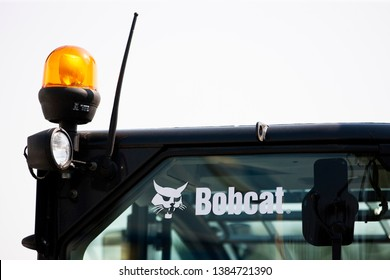 Vilnius/Lithuania April 24, 2019 Bobcat heavy duty equipment vehicle and logo. Bobcat Company is an American-based manufacturer of farm and construction equipment