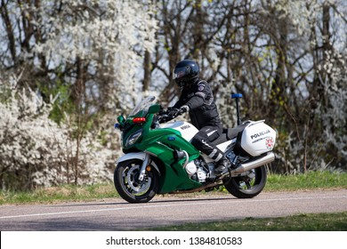 Vilnius/Lithuania April 28, 2019  Lithuanian Police Escort Motorcyclist on Yamaha FJR-1300 motorcycle. The Yamaha FJR1300 is sport touring motorcycle made by Yamaha Motor Company.