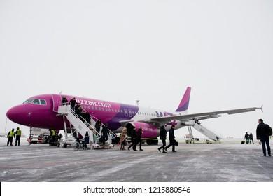 Vilnius/Lithuania December 12, 2016 WizzAir Airbus A320 lands at Vilnius airport.