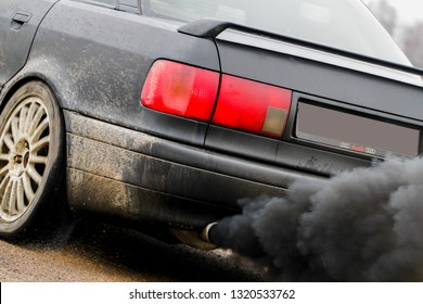 Vilnius/Lithuania February 22, 2019 combustion fumes coming out of car exhaust pipe