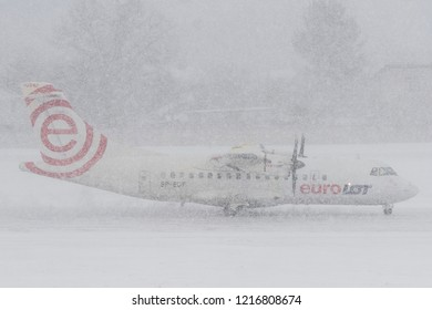 Vilnius/Lithuania January 4, 2014 EuroLOT Polish Airlines ATR 72 on runway in blizzard