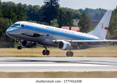 "Vilnius/Lithuania July 16, 2020 LOT - POLISH AIRLINES EMBRAER ERJ-175 (SP-LIM ) painted in ""Retro"" special colours."