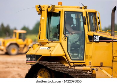 Vilnius/Lithuania June 11, 2019  Cat bulldozer. Caterpillar Inc. is an American Fortune 100 corporation which designs, develops, engineers, manufactures, markets and sells machinery, engines,