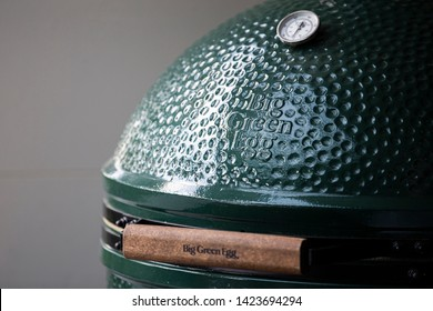 Vilnius/Lithuania June 13, 2019 The Big Closeup Of Green Ceramic BBQ Grill. Green Egg is the brand name of a kamado-style ceramic charcoal barbecue cooker.