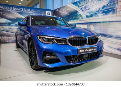 Vilnius/Lithuania March 1, 2019: metallic blue all new BMW 3 Series Sedan Berline 330i at BMW dealership Seventh generation, G20, manufactured and marketed by BMW