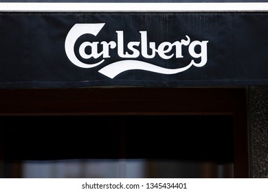 Vilnius/Lithuania March 20, 2019 Carlsberg logo on a wall. The Carlsberg Group is a Danish brewing company founded in 1847 by J.C. Jacobsen with headquarters located in Copenhagen, Denmark