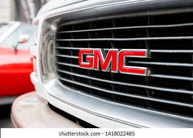 Vilnius/Lithuania May 29, 2019  The red GMC car emblem on a silver and black grill background - Image