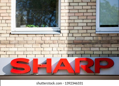 Vilnius/Lithuania May 8, 2019 Sharp logo on a facade. Sharp is a Japanese multinational corporation that designs and manufactures electronic products