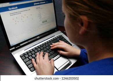 Vilnius/Lithuania November 4, 2014 Woman on a Computer Browsing Facebook Website