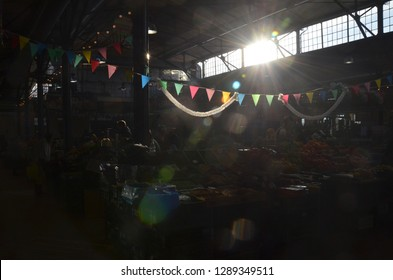 Vilnius/Lithuania_12 Jan 2019: People are doing shopping in a covered marketplace in Vilnius, Lithuania. A beautiful sunlight from the window.