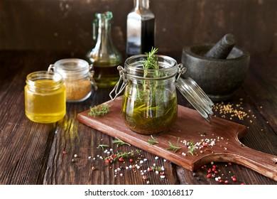 Vinaigrette dressing for salad. French cuisine. Olive oil, wine vinegar, honey, mustard and herbs ingredients