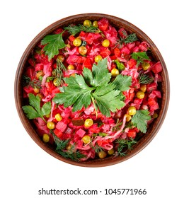 Vinaigrette salad with boiled vegetables, pickled cucumbers, sauerkraut and canned green peas in a clay bowl isolated on white. Traditional Russian snack. Vegetarian food. Top view.