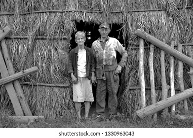VINALES, CUBA- APRIL 03,2003: Farmer couple posing in front of their drying shed in the Vinales Valley of Cuba