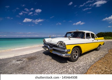 VINALES- FEBRUARY 4: Classic taxi parked near the beach on February 4, 2013 in Vinales. These old and classic cars are an iconic sight of the Cuba Island.
