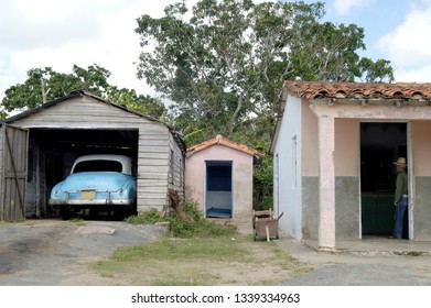 VINALES PINAR DEL RIO,CUBA-SEPTEMBER 23, 2016: Vintage car in a garage next to a small farmhouse in Vinales Pinar del Río Province Cuba Latin America