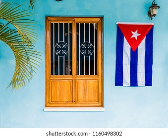 Vinales Valley, Pinar del Rio, Cuba. January 2018. A view of a cuban flag on a wall in Vinales Valley in Cuba.