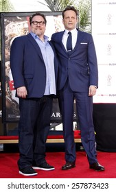 Vince Vaughn (with Jon Favreau) Places Handprints-Footprints In Cement At TCL Chinese Theatre in Hollywood on March 4, 2015.