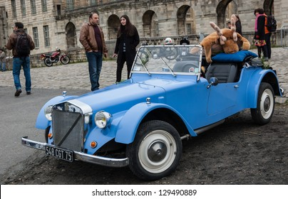 VINCENNES, FRANCE - JANUARY 6: Georges Irat car with funny elk toy takes part in antique cars exhibition on January 6, 2013 in Vincennes, France.