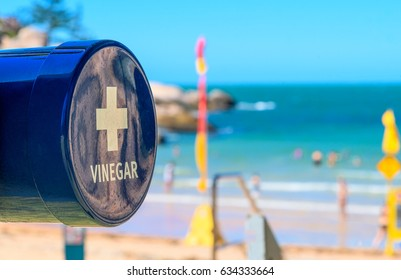A vinegar station on the beach for treating a marine stinger or jellyfish sting at Alma Beach, Magnetic Island, Queensland, Australia