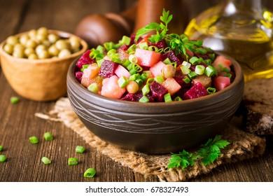 Vinegret - traditional Russian vegetable salad. Selective focus.