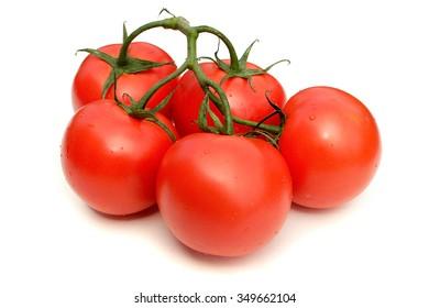 Vine-ripened tomatoes. Pure white background, soft shadows.