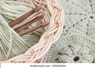 Vines basket with handmade crochet doilies, coasters and hooks. Cotton yarn for knitting. Work place