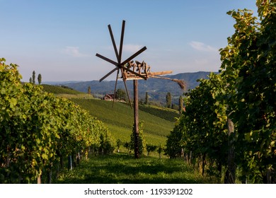 vineyard with windmill called klapotetz in south of styria,austria. old wine growing area named suedsteirische weinstrasse