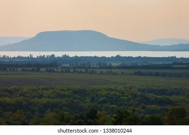 Vineyards and the Badacsony mountain with Lake Balaton after sunset in Hungary
