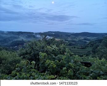 Vineyards with fool moon and smoke, Pozega, Slavonia region landscape, Croatia, Europe