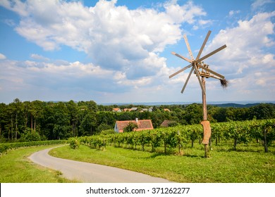 Vineyards with Klapotetz pinwheel along the South Styrian Wine Road in autumn, Austria Europe