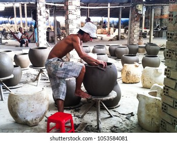 Vinh Long Province, Vietnam - December 16, 2013: peasant artist handcrafting ceramic pottery