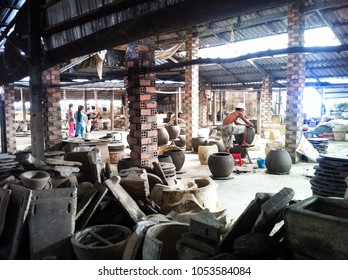 Vinh Long Province, Vietnam - December 16, 2013: peasant artist handcrafting ceramic pottery in factory