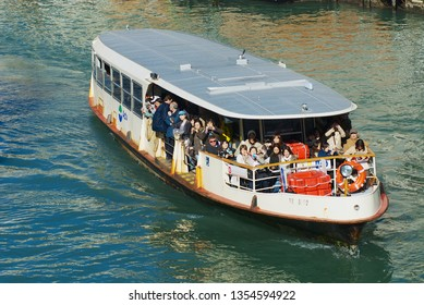 Vinice, Italy - February 26, 2007: Tourists enjoy ride by the Vaporetto public transportation boat at Grand Canal in Venice, Italy.