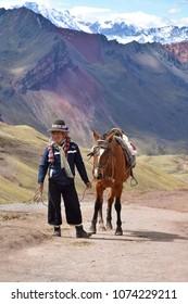 Vinicunca mountains, Cuzco, Peru: 27 May 2017: Inca at the Rainbow mountains near Cuzco